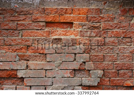 A red old brick masonry. Can be used as a background.