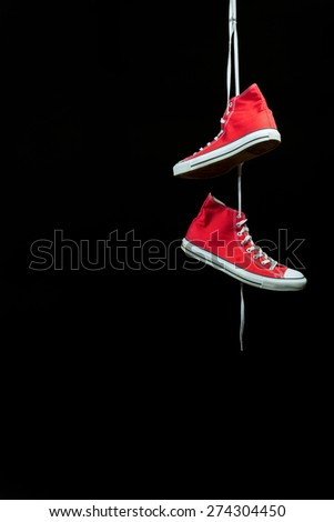 Pair of sneakers hanging