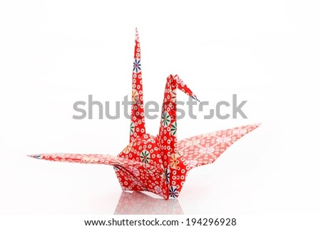 A red paper crane made by using origami. - stock photo