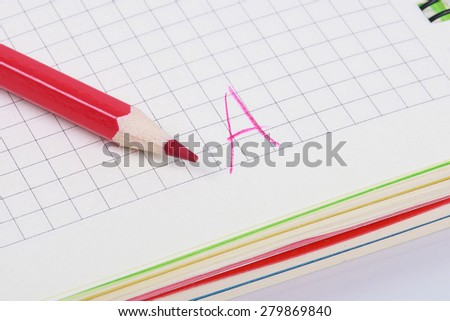 a red pencil on the notebook