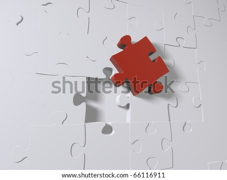 A red puzzle piece on grey pieces - stock photo