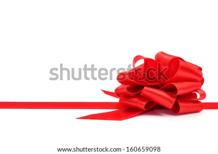 a red ribbon with a bow on a white background with a blank copy-space - stock photo