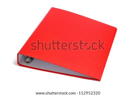 a red ring binder on a white background - stock photo