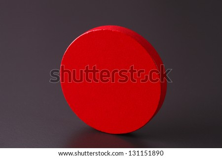 a red round wooden block
