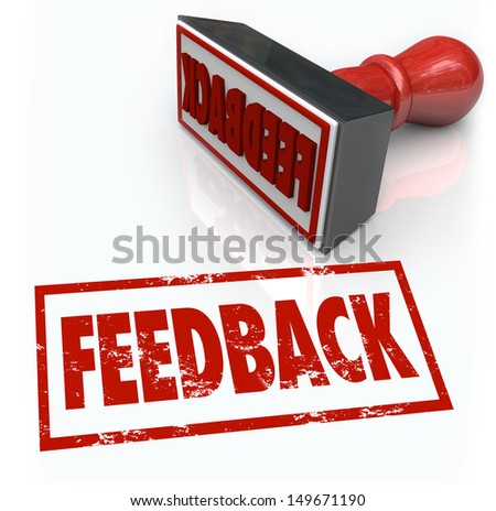 A red rubber stamp with the word Feedback to illustrate comments, reviews, criticism, opinions, judgment or approval - stock photo