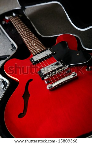 A red 1950's electro acoustic guitar - stock photo