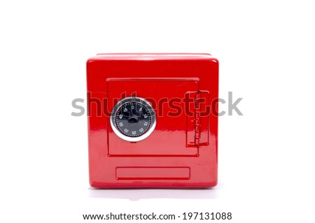 A red safe with a black lock dial. - stock photo