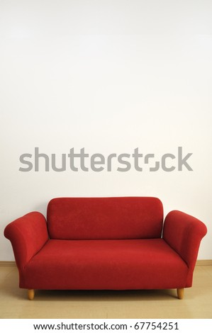 a red sofa - stock photo