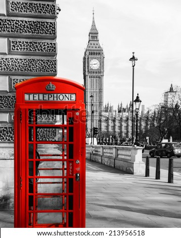 A red telephone booth in the foreground with the Big Ben behind. London. - stock photo