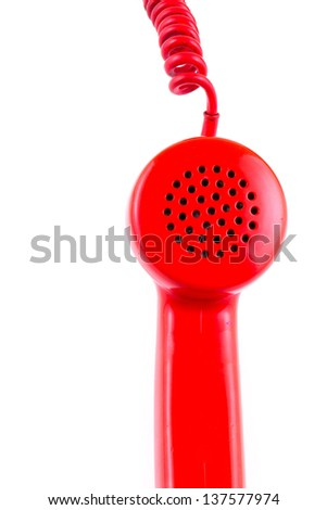 A red telephone receiver on white background - stock photo