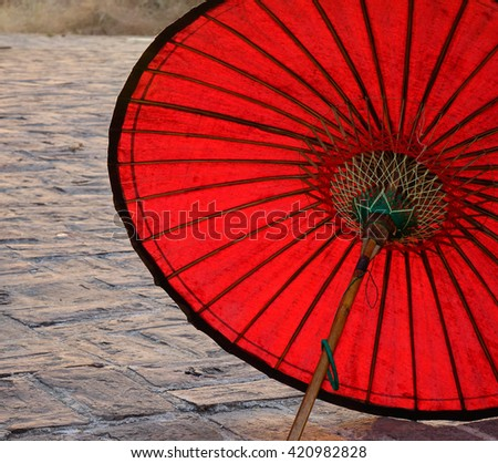 A red umbrella at the temple - stock photo