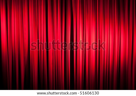 A red velvet stage curtain with vignetting for effect.  Part of a series - stock photo