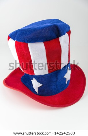 A red, white and blue Uncle Sam style hat isolated on a white background. - stock photo