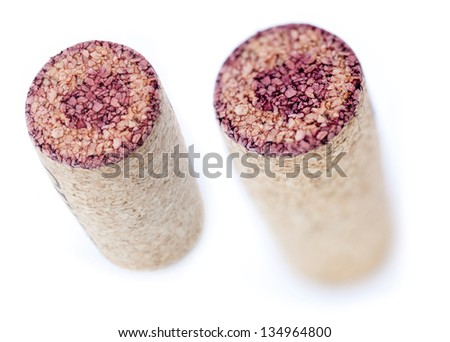 A red wine stained cork isolated on white background shot diagonally from a high angle. Two types of depth of field - shallow and deep. - stock photo
