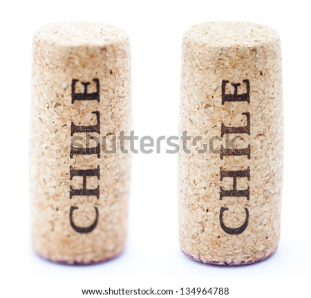 A red wine stained wine cork with 'Chile' written on it, isolated on white background, in vertical position with the writing pointing upwards. Two types of depth of field - shallow and deep. - stock photo