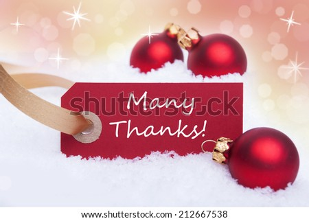 A Red WInter Label in the Snow with the Words Many Thanks on it - stock photo