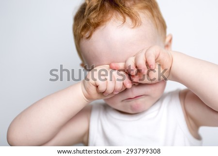 A redhead baby boy portrait over a isolated white background - stock photo