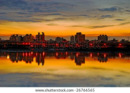 A reflection of the riverside after the sunset. - stock photo