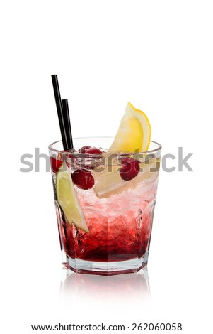 A refreshing cocktail in a glass with ice, berries and a slice of orange on a white background