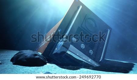 A regular aviation flight recorder black box painted in orange underwater resting on the ocean floor - stock photo