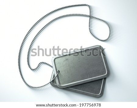 A regular set of blank military dog tag identity tags attached to a chain draped on an isolated background - stock photo