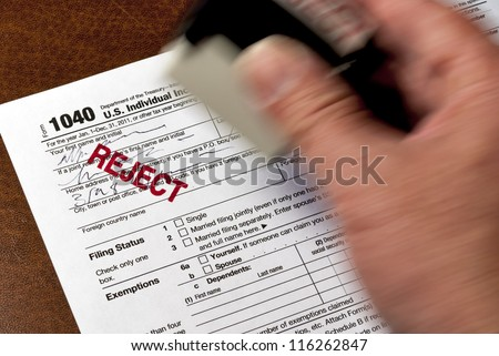 A reject stamp used to mark a tax form