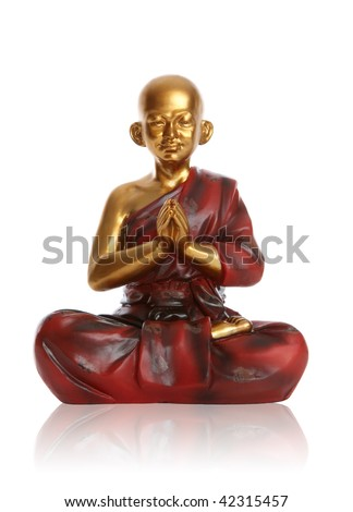 A religious spiritual golden monk statue praying over white - stock photo
