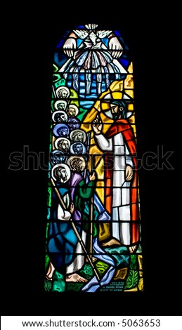 A religious stained glass window inside a church. The church is The Cathedral of Our Lady Assumed into Heaven and St Nicholas in Galway City, Ireland.