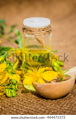 a remedy St. John's wort flower in a glass bottle closeup horizontal