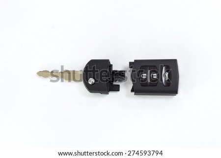 A remote car key isolated on white; Splited - stock photo