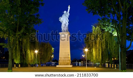 A replica of the iconic Statue of Liberty monument located by the Grenelle Bridge on the river Seine in Paris. - stock photo