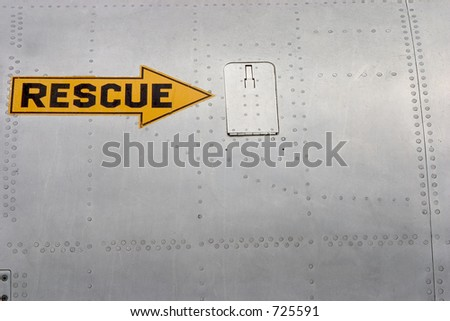 A rescue arrow painted on the side of a jet fighter.