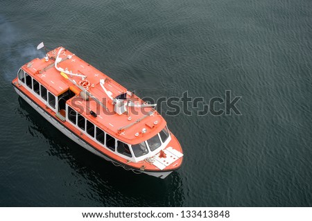 A rescue boat idles on the open sea. - stock photo