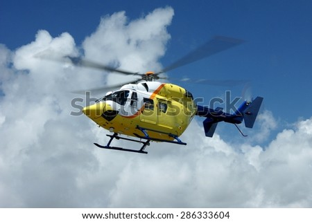 A rescue helicopter in the air - stock photo