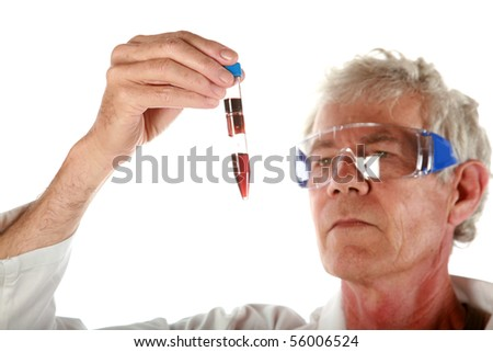 a research scientist examines a a test tube filled with blood  isolated on white - stock photo