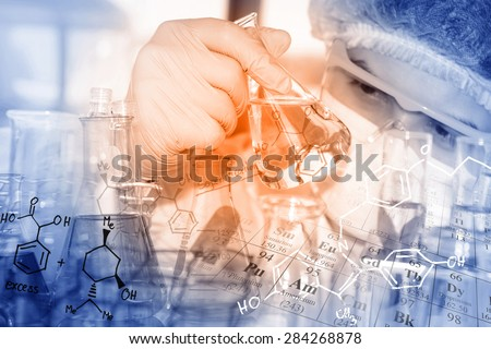 A researcher is doing his chemical lab research at laboratory. - stock photo