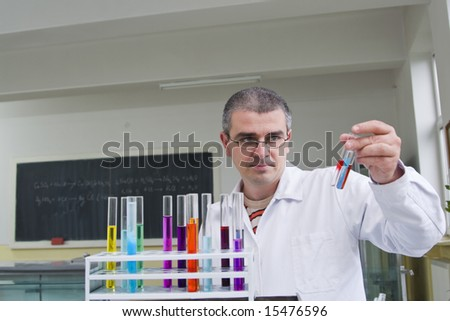 A researcher looking to some tubes in a laboratory.The inscriptions on the blackboard are mine.