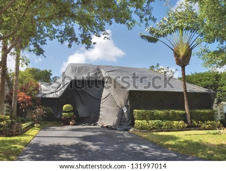 A residential dwelling is tented to exterminate termites and other insects. - stock photo