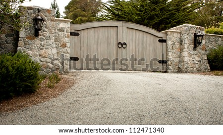 A Residential Entry Gate And Driveway Stock Photo