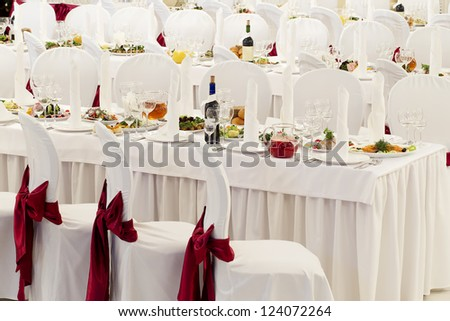 a restaurant banquet room decorated for a wedding party - stock photo