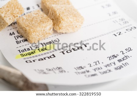 A restaurant receipt showing a sugar tax being charged - stock photo