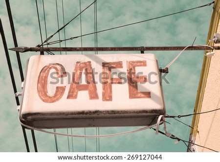 a retro cafe sign with a vintage filter - stock photo