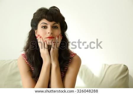 A retro girl sitting on the Sofa.  - stock photo