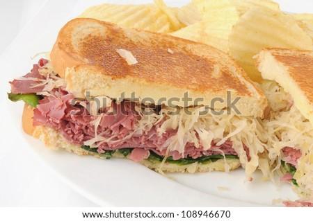 A reuben sandwich on a white background - stock photo