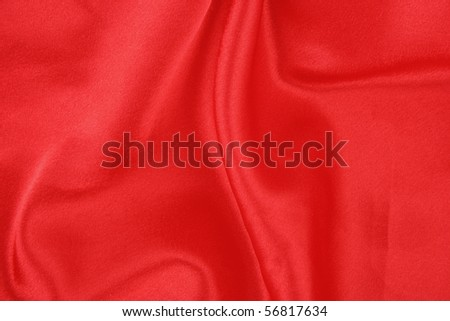 A rich red satin folded fabric background - stock photo