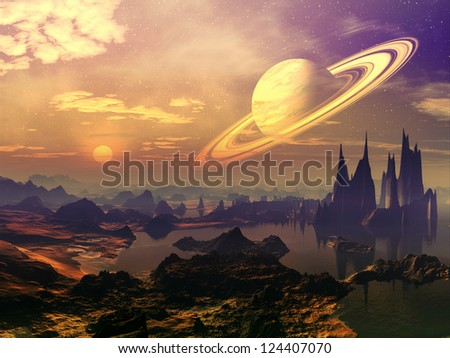 A ringed planet in orbit above a multicoloured alien landscape with lakes and strange rock formations. - stock photo