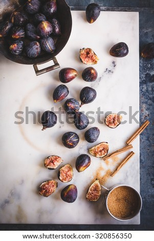 A ripe juicy fresh figs and caramel sugar over  on a old vintage marble table. Rustic style.  - stock photo