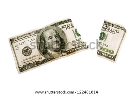 A ripped worn out one hundred dollar bill.  Isolated on white.   XXXL