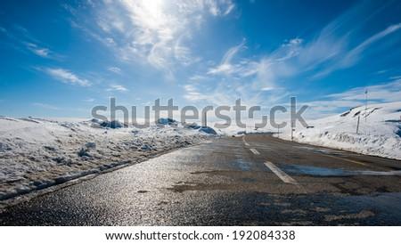 A road crossing the Norwegian national park Hardangervidden - stock photo
