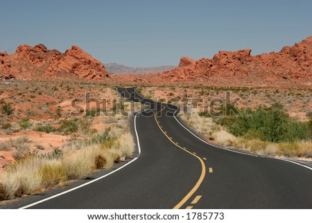 A road goes into Valley of Fire, Nevada - stock photo